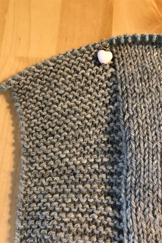 A project in stockinette stitch with an edge knitted in garter stitch to prevent the edges from curling.