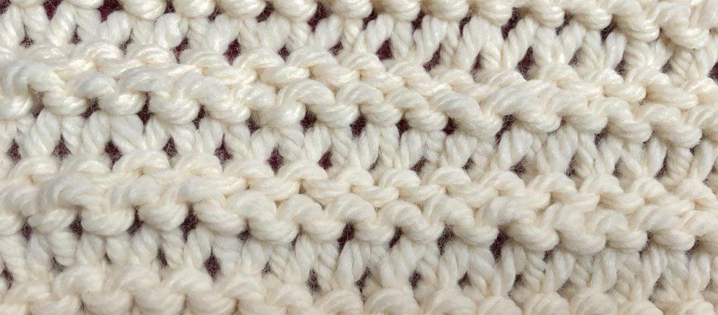 Yarn over garter knitting stitch
