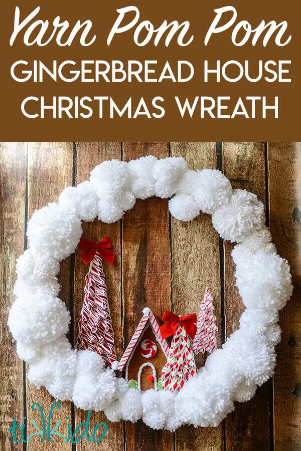 A Christmas wreath made of pompoms and a felt gingerbread house