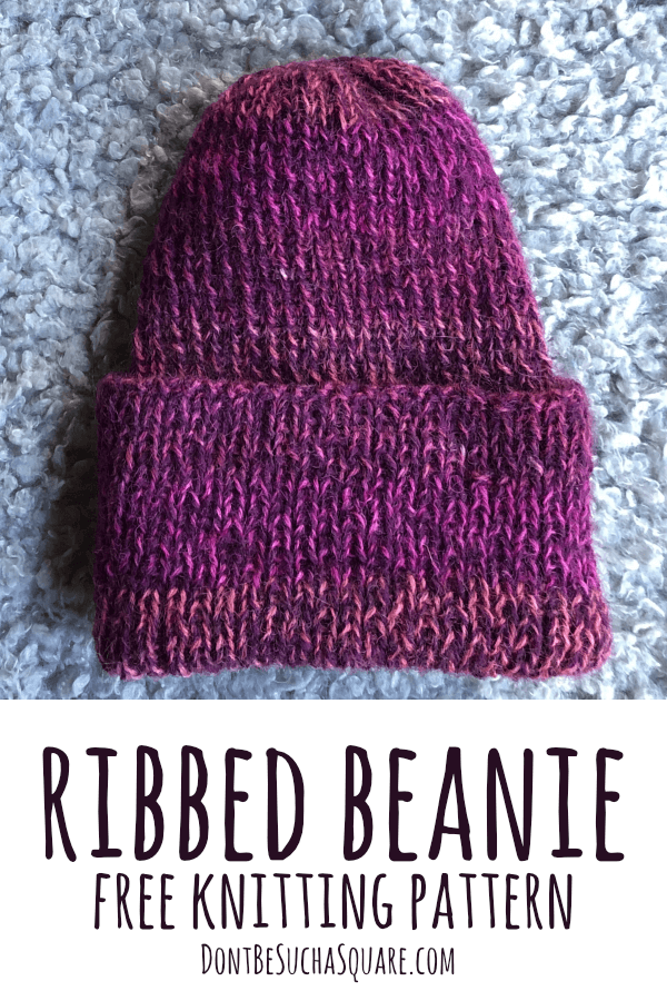 A picture of a ribbed beanie in purple and pink shades with the text ribbed beanie free knitting pattern on it.